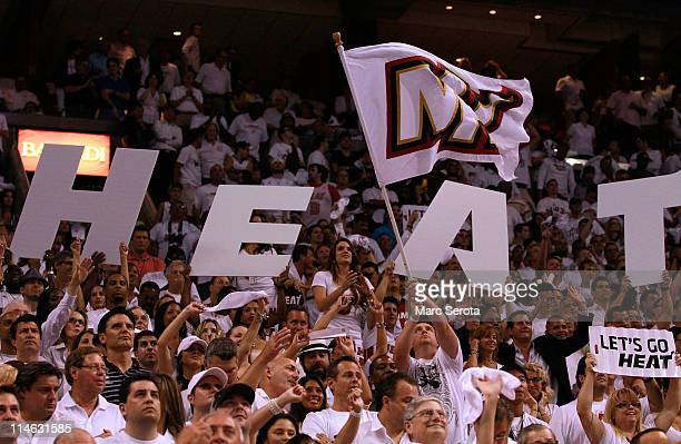 Fans of the Miami Heat support their team against the Chicago Bulls in Game Four of the Eastern Conference Finals during the 2011 NBA Playoffs on May...