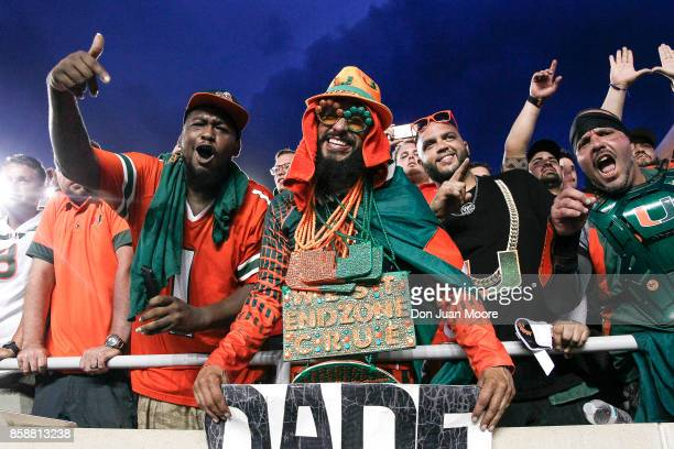 Fans of the Miami Hurricanes celebrates in the stands after the game against the Florida State Seminoles at Doak Campbell Stadium on Bobby Bowden...