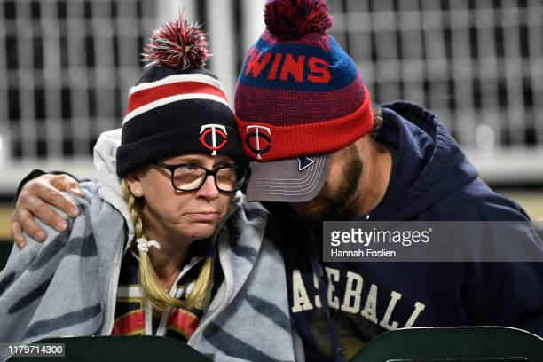 Fans of the Minnesota Twins sit in the stands following game three of the American League Division Series between the New York Yankees and the...