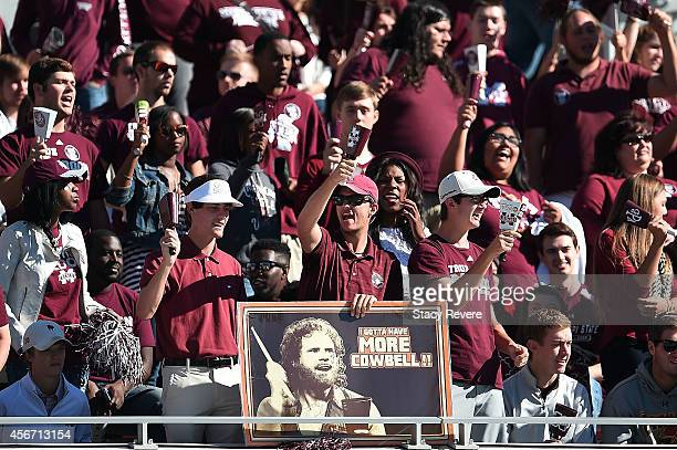 Fans of the Mississippi State Bulldogs cheer for their team during a game against the Texas AM Aggiesat Davis Wade Stadium on October 4 2014 in...