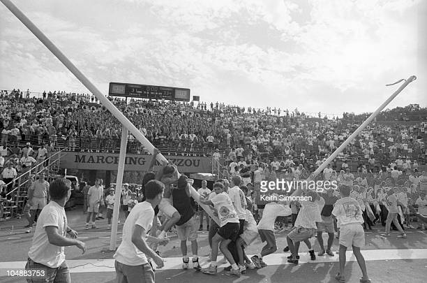 Fans of the Missouri Tigers pull down the goal posts following a loss to the Colorado Buffaloes at Faurot Field on October 6, 1990 in Columbia,...