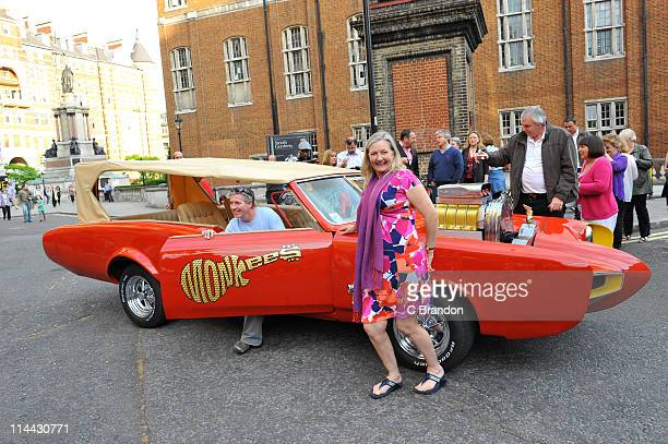 Fans of The Monkees pose with the modified Pontiac GTO Monkeemobile at Royal Albert Hall on May 19 2011 in London United Kingdom