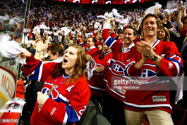 Fans of the Montreal Canadiens celebrate a late game tying goal against the Philadelphia Flyers in Game One of the Eastern Conference Semifinals of...