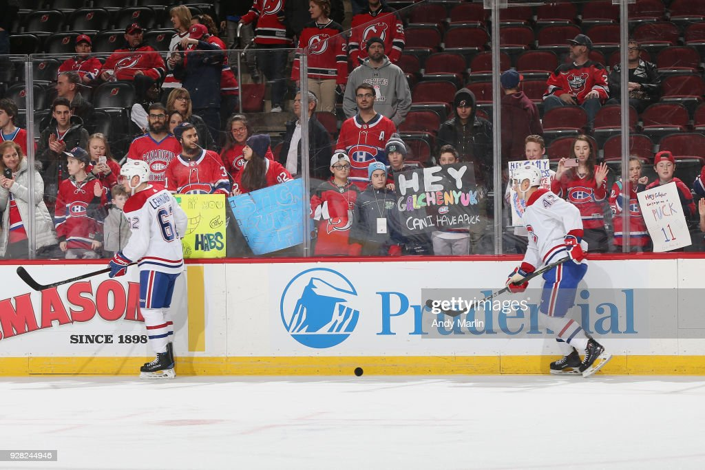 Fans of the Montreal Canadiens look on as Artturi Lehkonen #62 and Byron Froese #42 of the Montreal Canadiens warm up prior to game against the New Jersey Devils at Prudential Center on March 6, 2018 in Newark, New Jersey.