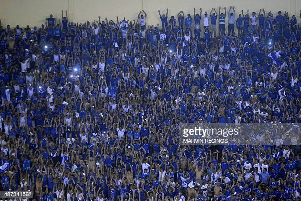 Fans of the National Soccer Team of El Salvador cheer at the Cuscatlan Stadium in San Salvador on September 8 in the return match of World Cup...