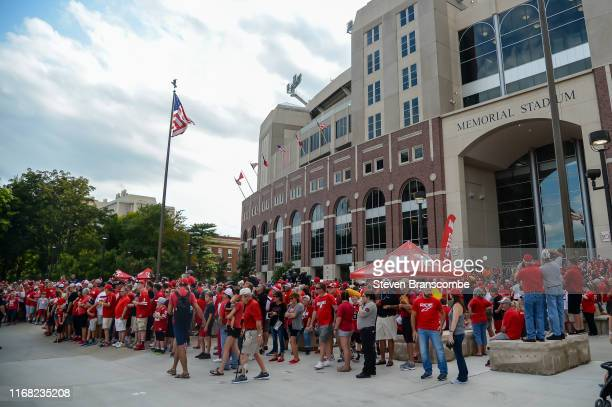 Fans of the Nebraska Cornhuskers await the arrival of the team before the game against the Northern Illinois Huskies at Memorial Stadium on September...