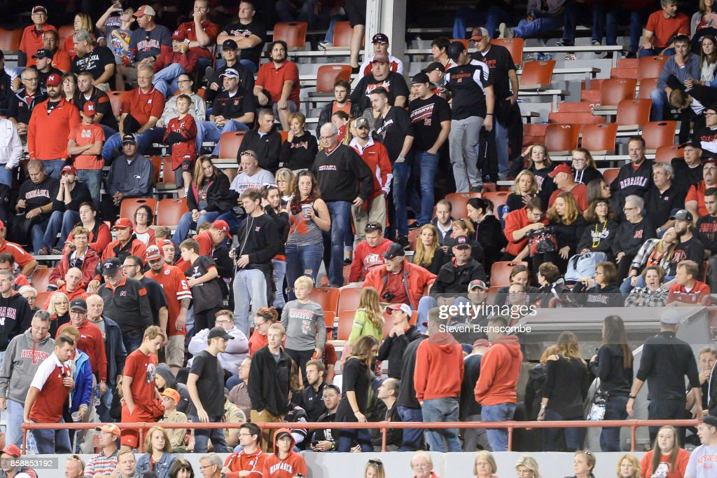 Fans of the Nebraska Cornhuskers head to the exits after a fourth quarter score by the Wisconsin Badgers at Memorial Stadium on October 7, 2017 in Lincoln, Nebraska.