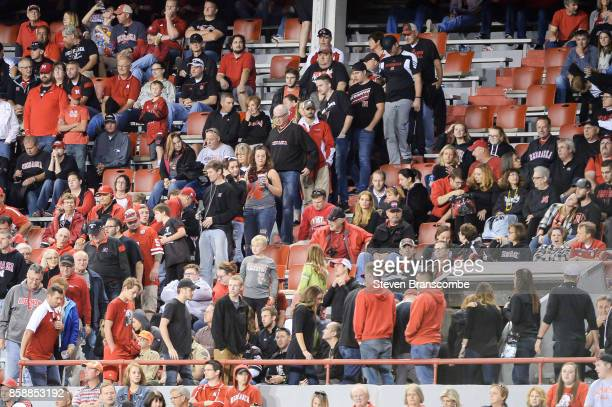 Fans of the Nebraska Cornhuskers head to the exits after a fourth quarter score by the Wisconsin Badgers at Memorial Stadium on October 7 2017 in...