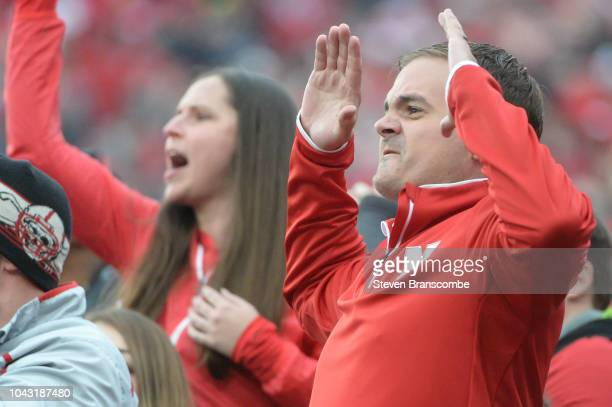 Fans of the Nebraska Cornhuskers react to a penalty call in the game against the Purdue Boilermakers in the second half at Memorial Stadium on...