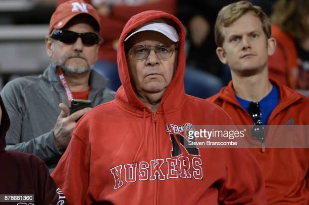 Fans of the Nebraska Cornhuskers watch late game action against the Iowa Hawkeyes at Memorial Stadium on November 24 2017 in Lincoln Nebraska