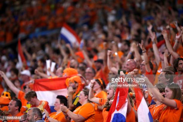 Fans of the Netherlands celebrate during the 2019 FIFA Women's World Cup France Semi Final match between Netherlands and Sweden at Stade de Lyon on...