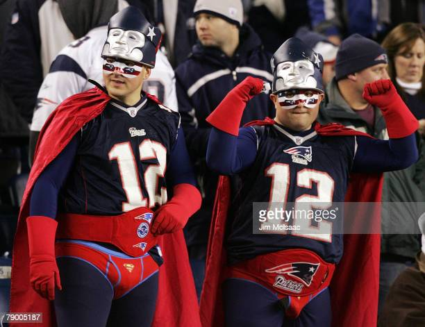 Fans of the New England Patriots dressed in superhero costumes watch as their team takes on the Jacksonville Jaguars during the AFC Divisional...