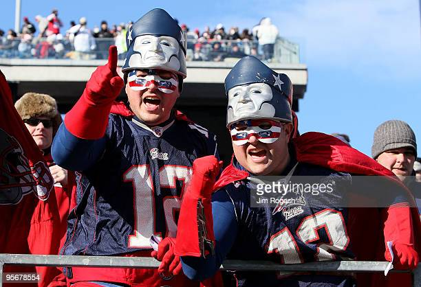 Fans of the New England Patriots support their team against the Baltimore Ravens during the 2010 AFC wildcard playoff game at Gillette Stadium on...