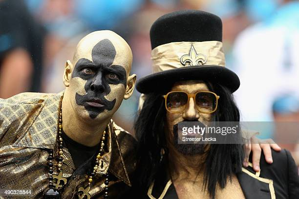 Fans of the New Orleans Saints watch on against the Carolina Panthers during their game at Bank of America Stadium on September 27 2015 in Charlotte...