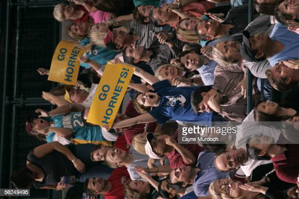 "Fans of the New Orleans/Oklahoma City Hornets hold up signs that read ""Go Hornets"" in support of their team against the Dallas Mavericks November 12,..."