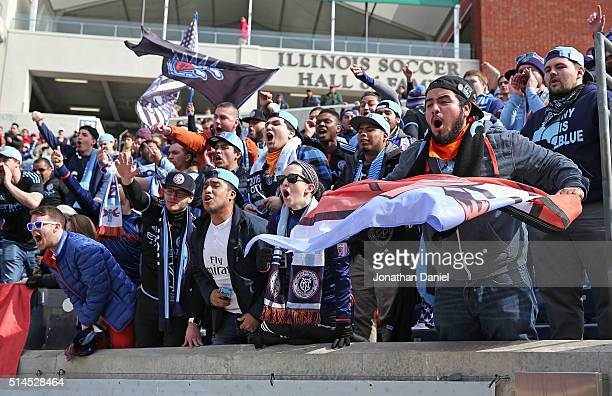 Fans of the New York City FC cheer on their team against the Chicago Fire at Toyota Park on March 6 2016 in Bridgeview Illinois