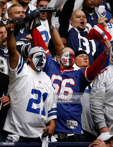Fans of the New York Giants and the Dallas Cowboys cheer during the NFC Divisional Playoff game at Texas Stadium on January 13 2008 in Irving Texas