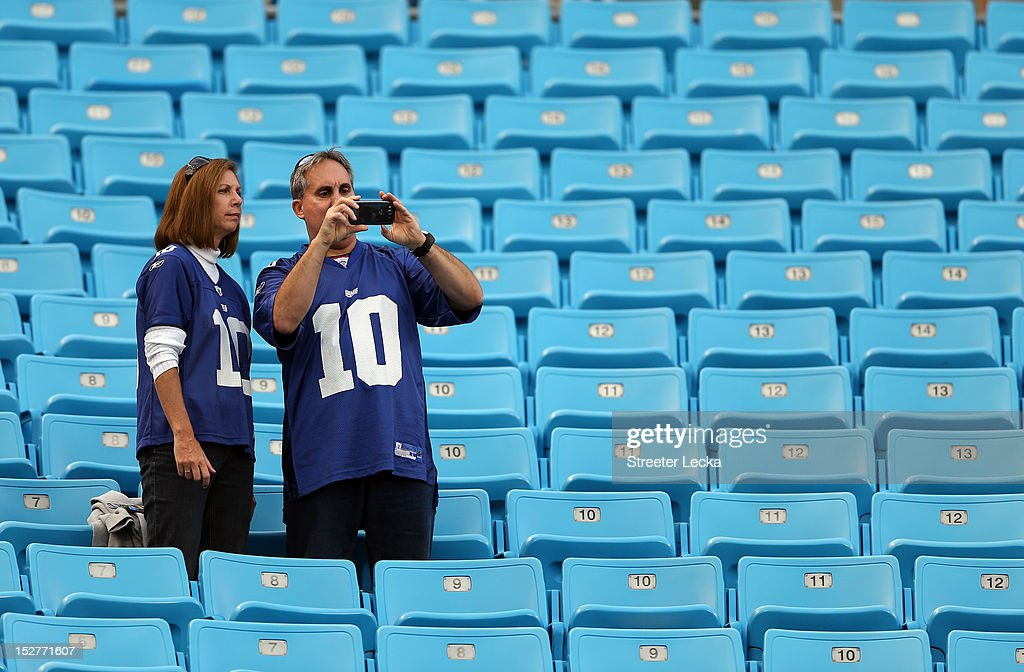 Fans of the New York Giants take pictures from the stands before their game at Bank of America Stadium on September 20, 2012 in Charlotte, North Carolina.