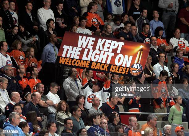 Fans of the New York Islanders attend the home opener against the Carolina Hurricanes on October 8, 2005 at Nassau Coliseum in Uniondale, New York....