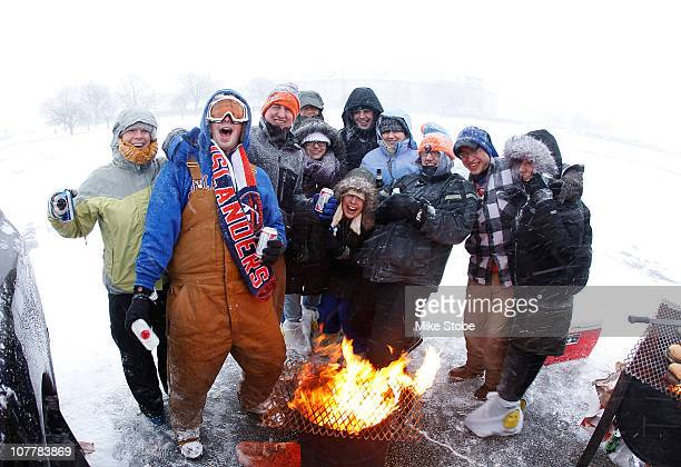 Fans of the New York Islanders from the town of Garden City, NY, tail gate in the parking lot during a snow blizzard prior to the game against the...