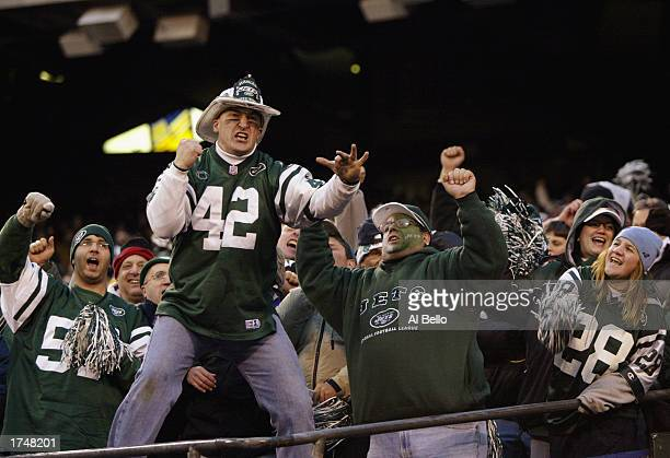 Fans of the New York Jets cheer on their team during the AFC wildcard game against the Indianapolis Colts at Giants Stadium on January 4 2003 in East...