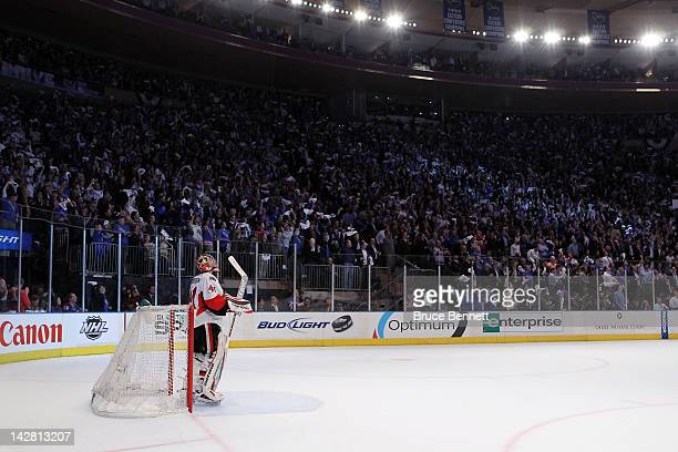 Fans of the New York Rangers cheer as goalie Craig Anderson of the Ottawa Senators looks on after he gave up a third period goal to Brian Boyle of...
