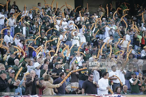 Fans of the Oakland Athletics cheer during Game One of the American League Championship Series against the Detroit Tigers at McAfee Coliseum on...
