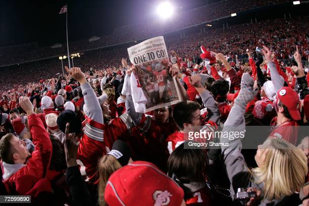 Fans of the Ohio State Buckeyes celebrate on the field with players after their 32-39 win against the Michigan Wolverines November 18, 2006 at Ohio...