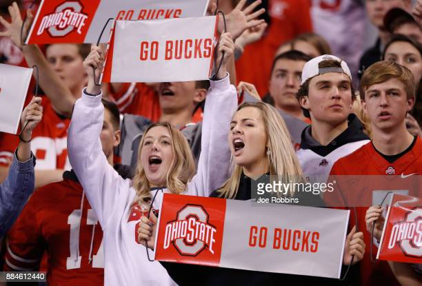 Fans of the Ohio State Buckeyes cheer as they take on the Wisconsin Badgers during the Big Ten Championship game at Lucas Oil Stadium on December 2...