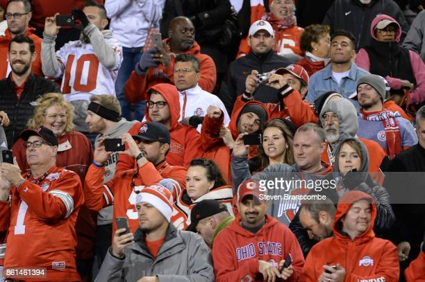 Fans of the Ohio State Buckeyes take photos of the team leaving the field in the game against the Nebraska Cornhuskers at Memorial Stadium on October...