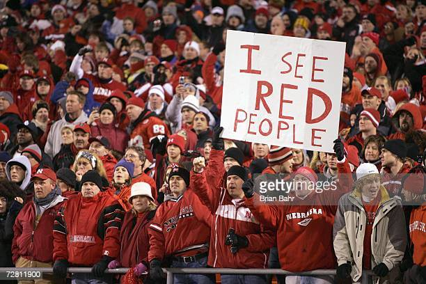Fans of the Oklahoma Sooners cheer against the Nebraska Cornhuskers during the 2006 Dr Pepper Big 12 Championship on December 2 2006 at Arrowhead...