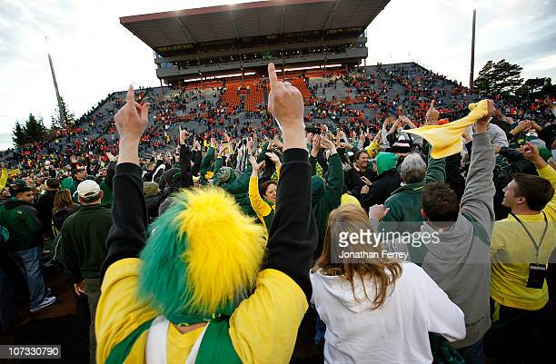 Fans of the Oregon Ducks rush onto te field after te 3720 victory over the Oregon State Beavers during the 114th Civil War on December 4 2010 at the...