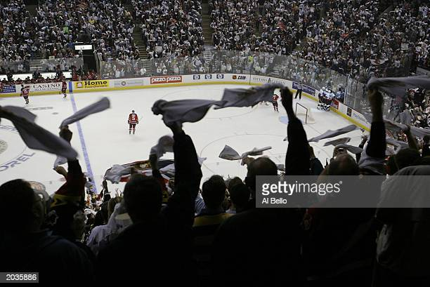 Fans of the Ottawa Senators cheer Magnus Arvedson's goal against Martin Brodeur of the New Jersey Devils in the 1st period during game 7 of the NHL...