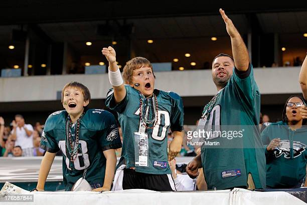 Fans of the Philadelphia Eagles cheer after a first down during a preseason game against the Carolina Panthers on August 15 2013 at Lincoln Financial...