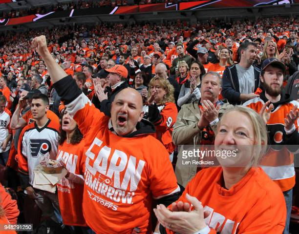 Fans of the Philadelphia Flyers celebrate a second period goal against the Pittsburgh Penguins in Game Three of the Eastern Conference First Round...