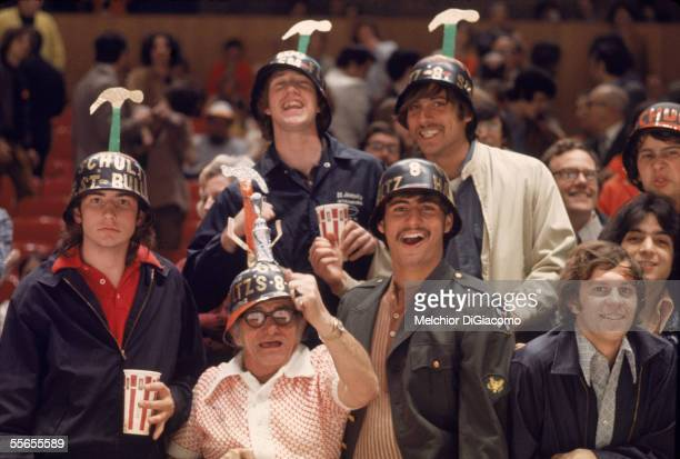 Fans of the Philadelphia Flyers hockey team pose for a photo wearing their helmets topped with hammers at the Spectrum Philadelphia Pennsylvania...