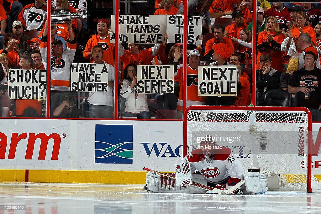 Fans of the Philadelphia Flyers hold up signs behind Jaroslav Halak #41 of the Montreal Canadiens in Game 5 of the Eastern Conference Finals during the 2010 NHL Stanley Cup Playoffs at Wachovia Center on May 24, 2010 in Philadelphia, Pennsylvania.