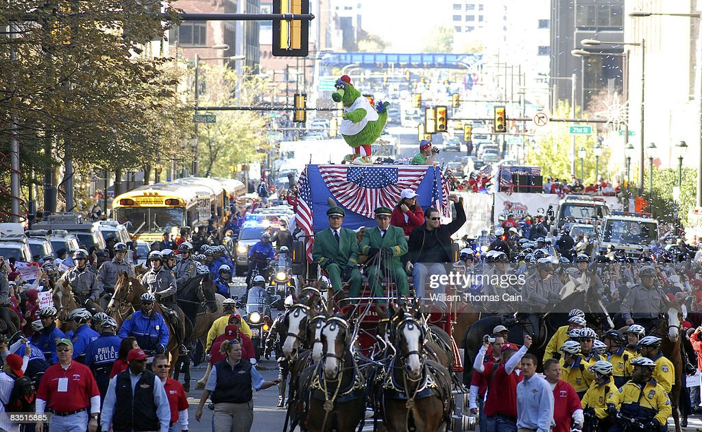 Fans of the Philadelphia Phillies celebrate during the World Championship Parade October 31, 2008 in Philadelphia, Pennsylvania. The Phillies defeated the Tampa Bay Rays to win their first World Series in 28 years.