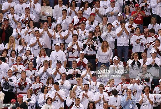 Fans of the Phoenix Coyotes cheer in Game One of the Western Conference Quarterfinals against the Detroit Red Wings during the 2010 NHL Stanley Cup...