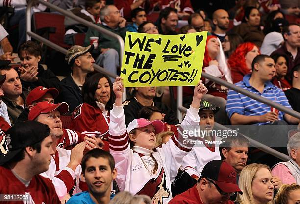 Fans of the Phoenix Coyotes hold up a sign during the NHL game against the Nashville Predators at Jobingcom Arena on April 7 2010 in Glendale Arizona...