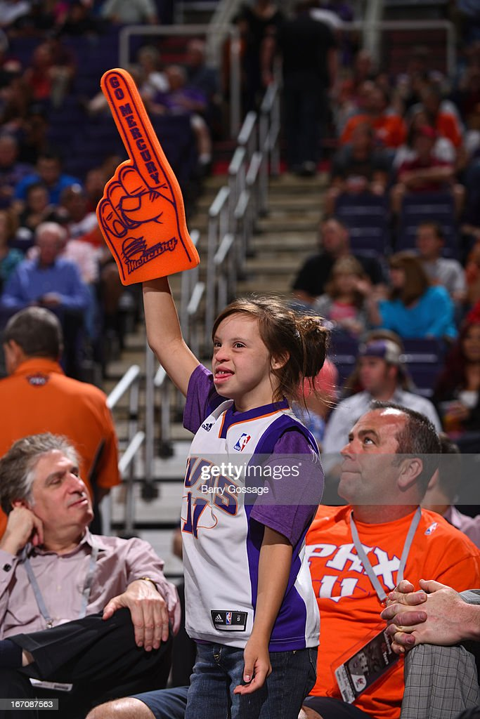 Fans of the Phoenix Suns get excited against the Washington Wizards on March 20, 2013 at U.S. Airways Center in Phoenix, Arizona.