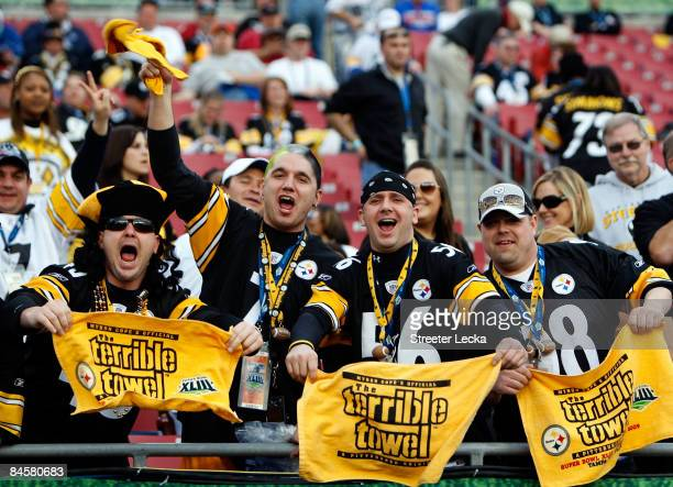 Fans of the Pittsburgh Steelers wave their terrible towels against the Arizona Cardinals during Super Bowl XLIII on February 1, 2009 at Raymond James...
