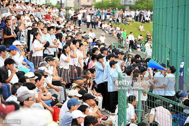 Fans of the PL Gakuen baseball team cheer during the game against Higashiosaka Univ Kashiwara at the first round of the Japanese High School Baseball...