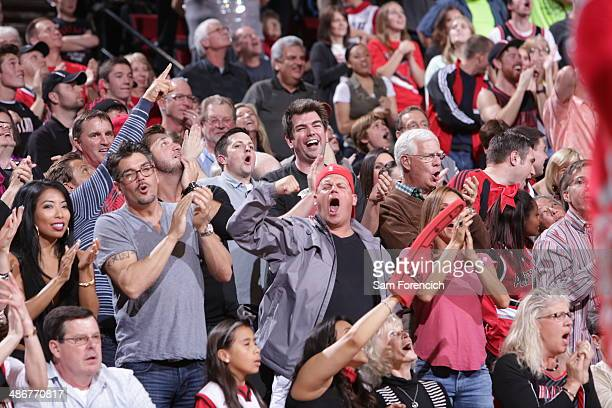 Fans of the Portland Trail Blazers cheer during a game against the Houston Rockets in Game Three of the Western Conference Quarterfinals during the...