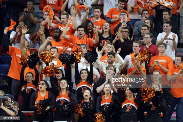 Fans of the Princeton Tigers cheer after a basket during a game against the Pennsylvania Quakers at The Palestra during the semifinals of the Ivy...