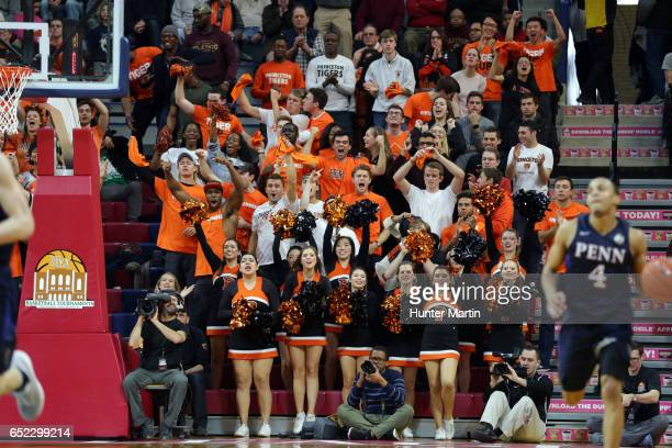 Fans of the Princeton Tigers cheer during a game against the Pennsylvania Quakers at The Palestra during the semifinals of the Ivy League Basketball...