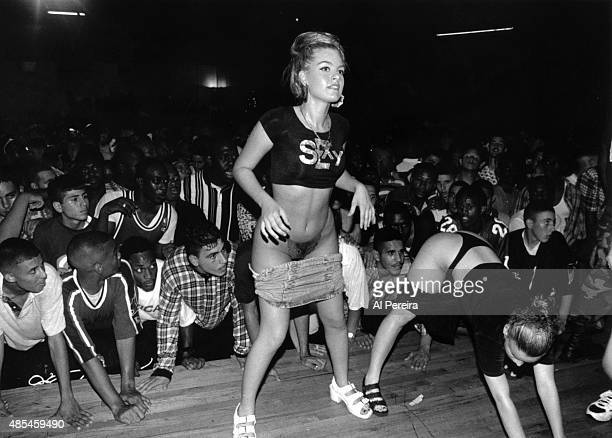 Fans of the rap group '2 Live Crew' watch as their dancers perform at Zippers in circa 1988 Miami