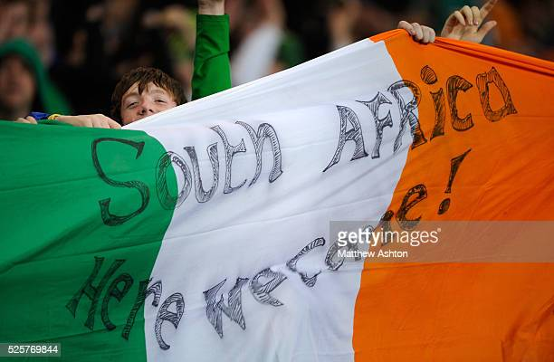 Fans of the Republic of Ireland hold up a national flag with the hopeful message of SOUTH AFRICA HERE WE COME