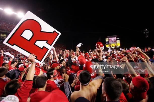 Fans of the Rutgers Scarlet Knights rush the field after their team defeated the Louisville Cardinals 28-25 at Rutgers Stadium on November 9, 2006 in...