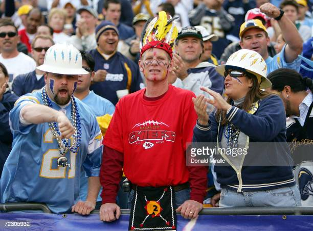 Fans of the San Diego Chargers taunt a fan of the Kansas City Chiefs after a scoring drive by the Chargers at Qualcomm Stadium on January 2, 2004 in...